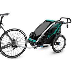 Thule Chariot Lite1 Przyczepka rowerowa zielony/czarny 2018 Przyczepki dla dzieci Przy złożeniu zamówienia do godziny 16 ( od Pon. do Pt., wszystkie metody płatności z wyjątkiem przelewu bankowego), wysyłka odbędzie się tego samego dnia.