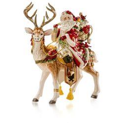 Figurka Mikołaja z prezentami na reniferze